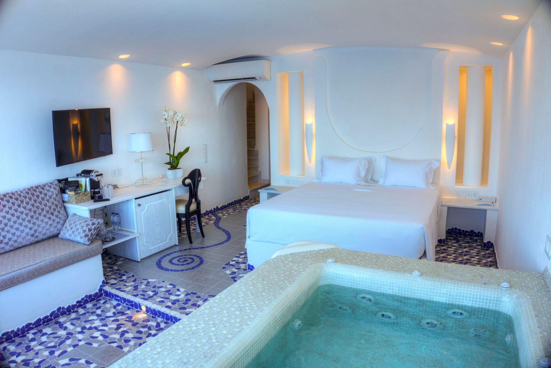 Cave Pool Suite   Bedroom Area   Astarte Suites Hotel
