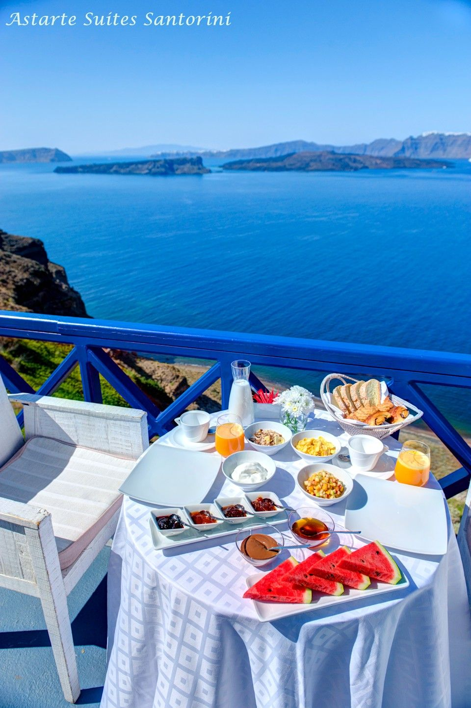Breakfast served at guests private terrace overlooking sea-volcano-caldera views